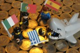 Euro coins with kids toys and a shark